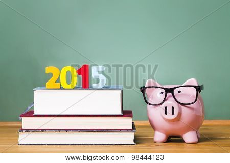 Class Of 2015 Theme With Textbooks And Piggy Bank With Glasses