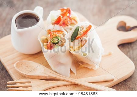 Fresh Spring Rolls On Wooden Table