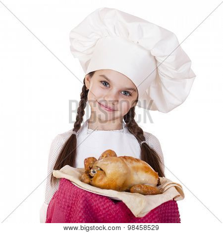 Little girl in a white apron holds on a plate of fried chicken, isolated on white background