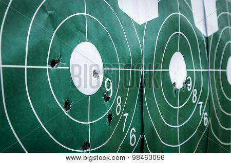 shooting shooting on the street ground guns shooting shells on the ground bullets on the table shot shots on target target bullet grapeshot gunpowder smoke loud noise poster
