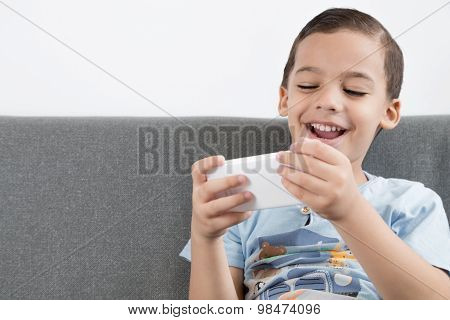 Happy boy using mobile.