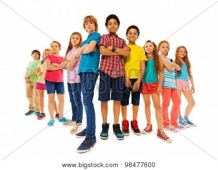 Many confident boys and girls stand together