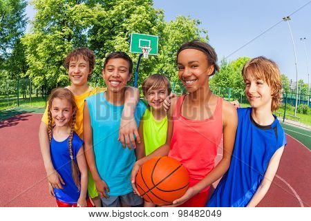 Basketball teenage team standing close after game