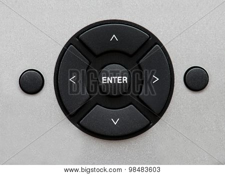 A circular selector and enter key.  Commonly seen on typical remote control units. directional buttons seen on audio, and visual, equipment.