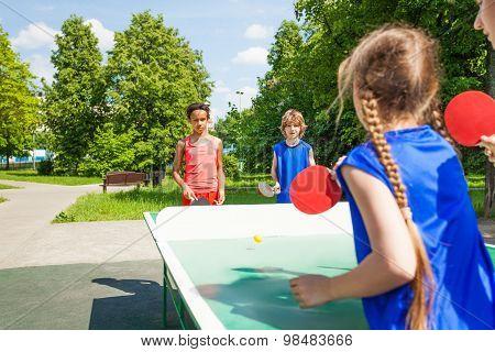 Four international friends play table tennis