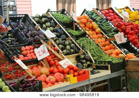 Fruit And Vegetable Stand With Basket Full Of Seasonal Fruits In The Local Market Of The City
