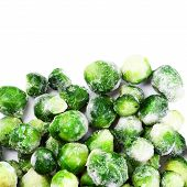 Frozen Brussels sprouts cabbage isolated on white background top view poster