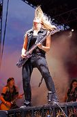 June 28 2014 - Bay City Michigan - Alice Cooper Raise the Dead Tour - Nita Strauss shreds the guitar during a live concert with Alice Cooper in Veterans Memorial Park located in Bay City Michigan poster