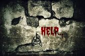Help bloody on dirty brick wall with vintage and vignette tone - Horror and Scary Wall background poster