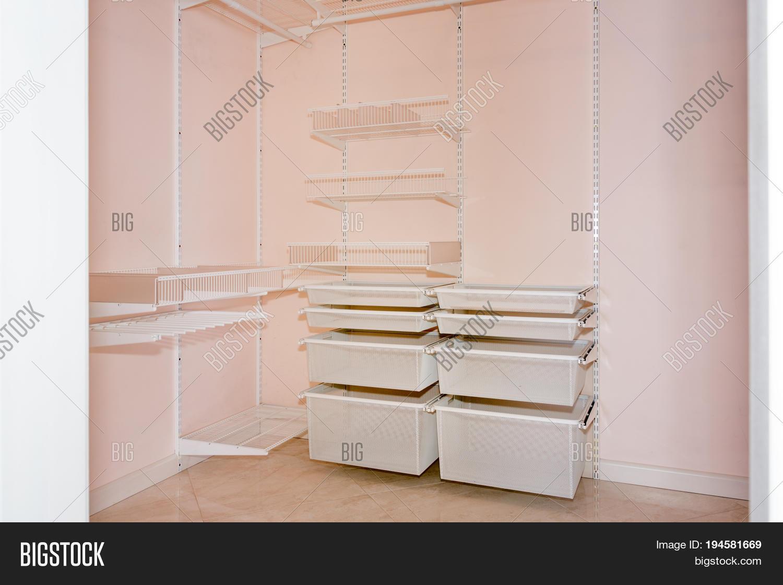empty walk in closet. Empty Walk-in Closet With Shelves. Dressing Room Interior Elements Empty Walk In