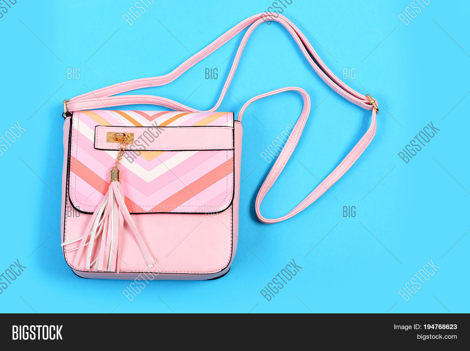 f7981a3aed Purse in light pink color with stripes. Handbag for women isolated on cyan  blue background. Accessory in modern style made of leather. Fashion and  glamour ...