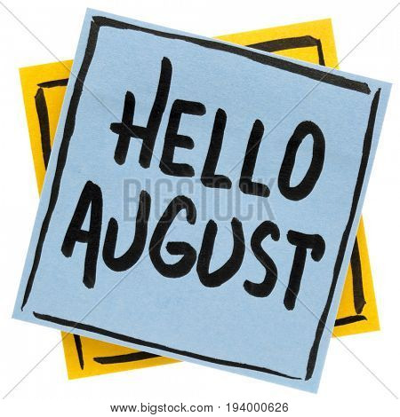 Hello August - handwriting in black ink on an isolated sticky note