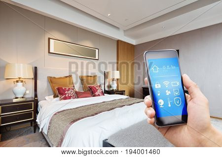 mobile phone with apps in modern luxury bedroom