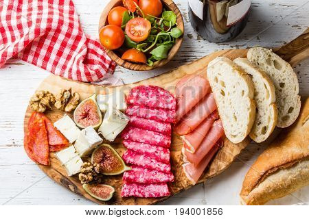 Antipasto. Olive Board With Salami, Ham Serrano, Cheese, Nuts And Ciabatta Bread