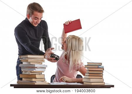 The young man tries to wake the sleeping girl who is late for examination on a white background.