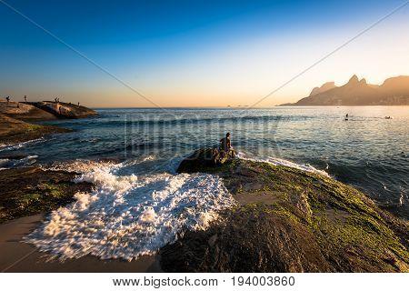 Waves Washing the Arpoador Rock During Sunset in Rio de Janeiro