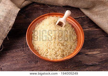Rice, Indian Basmati, Pakistani Basmati Uncooked On Brown Background
