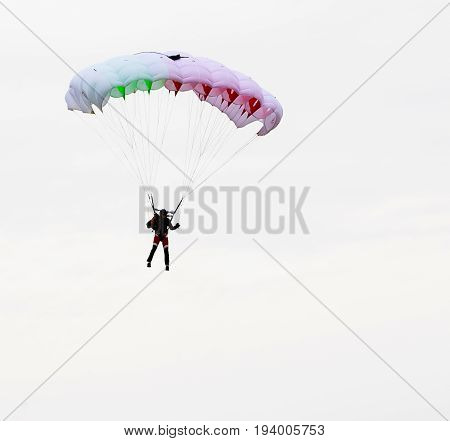 Jump Of Paratrooper With Full Color Parachute, Isolated Isolated On A White Background.