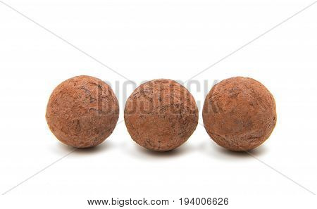 Brown chocolate truffle bonbon isolated on white