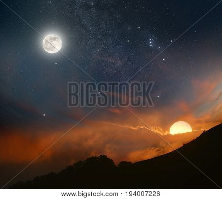 Abstract picture of the night sky opposite the rising sun