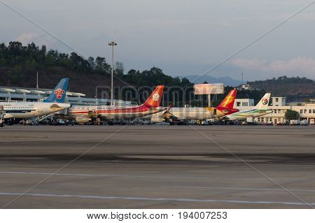 Sanya Hainan China April 25 2017 - Four aircraft near different airlines and models are near the terminal of domestic airlines of Phoenix Airport