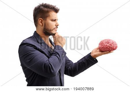 Pensive man looking at a brain model isolated on white background