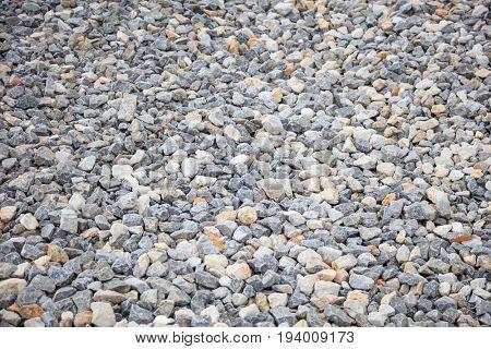 Grey crashed stones - rubbles texture  background