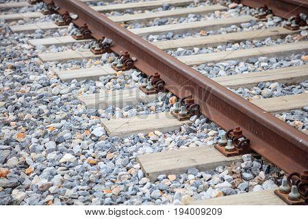 Railroad tracks on crashed stones - rubbles background