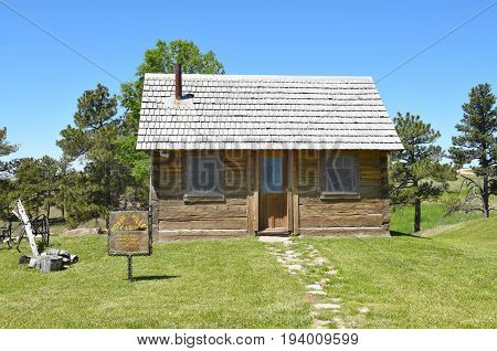NEWCASTLE, WYOMING - JUNE 23, 2017: Anna Miller Museum Cabin. The main museum is housed in the Wyoming Army National Guard Cavalry Stable, the last calvary stable in Wyoming.