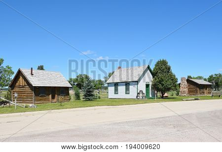NEWCASTLE, WYOMING - JUNE 23, 2017: Anna Miller Museum cabins and school house. Housed in the Wyoming Army National Guard Cavalry Stable, the last calvary stable in Wyoming.