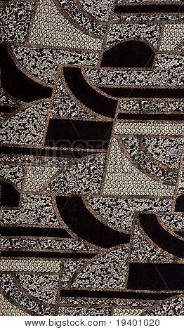 Patrón de tejido negro con oro. Patrón de tela negra con oro