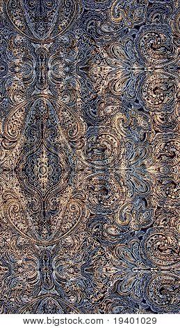 Tejido azul con el patrón oro