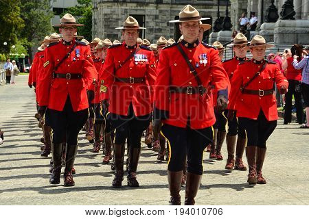Victoria BC,Canada,June 10th 2014.RCMP Police in their uniforms march in unison in a parade in Victoria BC.honoring fallen fellow officers.
