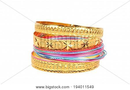 Golden bracelets , close up and a white background