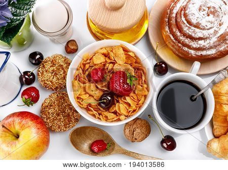Breakfast fresh croissant coffee berry and honey. Still life of sweets and fruits top view.