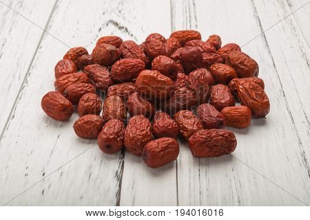 dried jujube on white wood traditional chinese herbal medicine