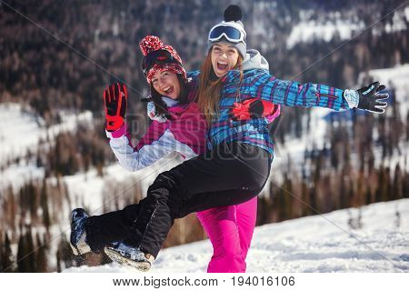 Cheerful snowboarder posing on top of a mountain. Sheregesh. Russia.