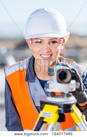 Surveyor engineer worker making measuring with theodolite equipment