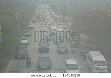 BANGKOK, THAILAND - SEPTEMBER 20, 2016: Photo of the air pollution and smoke from cars and motorcycles in Bangkok city on September 20, 2016 in Bangkok, Thailand