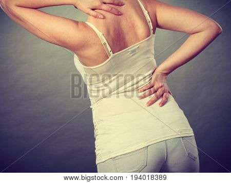 Health problem skin diseases. Young woman scratching her itchy back with allergy rash