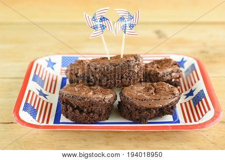 Close-up on a dish with chocolate brownie in muffin format and 4th of July decoration