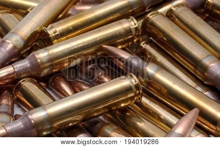 Brass 223 ammo piled together in a heap