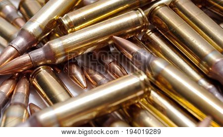 A close up of brass 223 ammo