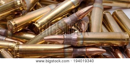 Brass 223 ammo in a pile on top of each other