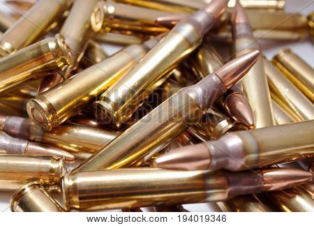 Unfired 223 brass ammo close up in a pile