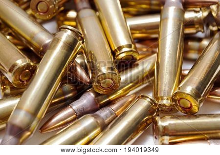 A close up of a pile of 223 brass ammo