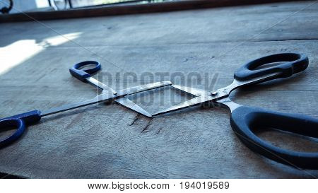 dark shadow in Stylish Professional Barber Clippers on wood background with copy space