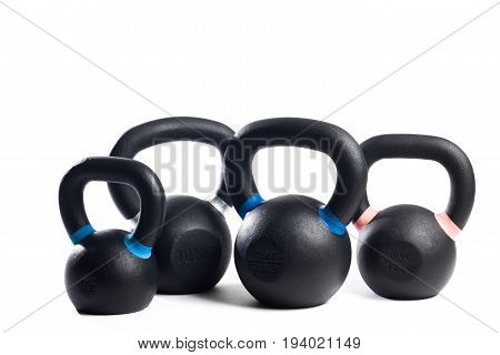 Four black metal weight on isolated background