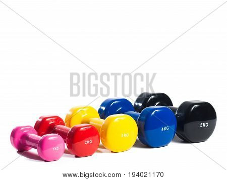 Five multi-colored metal dumbbell on isolated background in one row