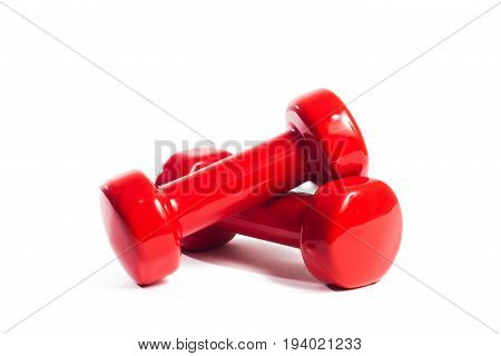 Two red dumbbells on an isolated background In a random order
